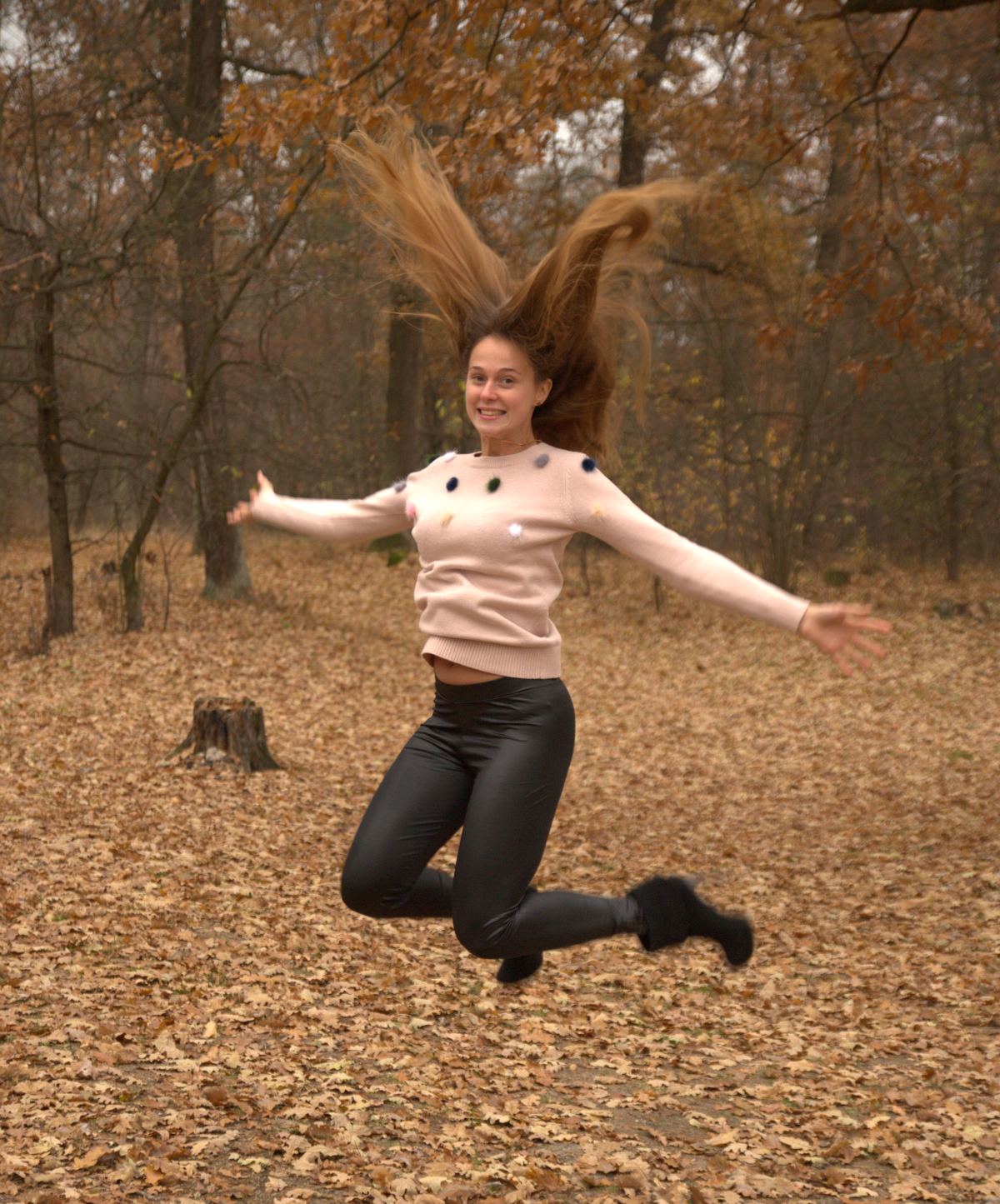 julia-jumping-autumn